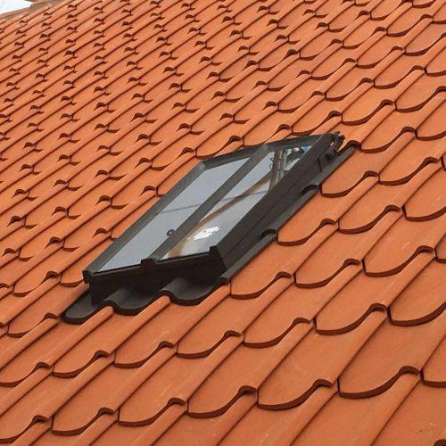 Cast iron roof window